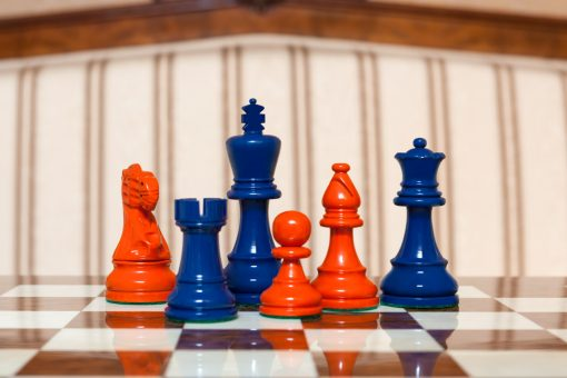 """Earl Steel Blue and Orange Chess Pieces on the red 50 cm """"Cordoba"""" Chess Board"""