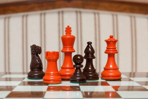"""Earl Orange and Brown Chess Pieces on the red 50 cm """"Cordoba"""" Chess Board"""