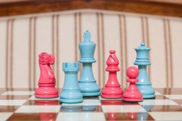 """Earl Turquoise and Pink Chess Pieces on the red 50 cm """"Cordoba"""" Chess Board"""
