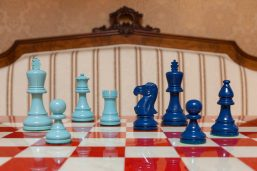 """Earl Turquoise and Steel Blue Chess Pieces on the red 51 cm """"Bologna"""" Chess Board"""