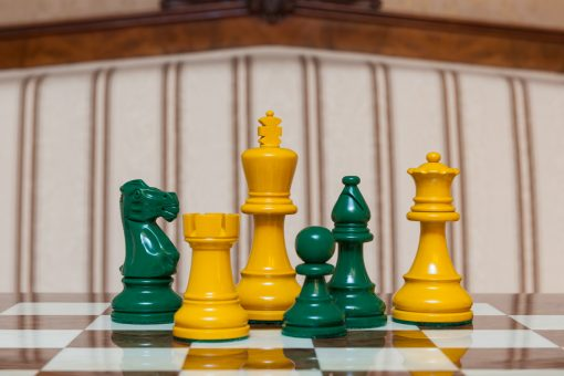 """Earl Yellow and Green Chess Pieces on the red 50 cm """"Cordoba"""" Chess Board"""