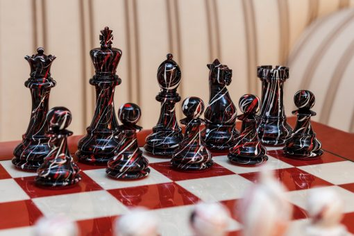 "New York Series Chess Pieces on the red 51 cm ""Bologna"" Chess Board"