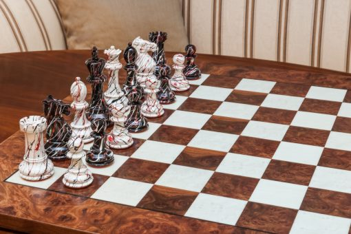 "New York Series Chess Pieces on the red 51 cm ""Pisa"" Chess Board"