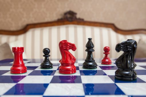 Black and Earl chessmen on a blue board