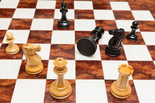 Staunton Evolution 4.25 inch chess pieces in Lacquered Ebony and Boxwood