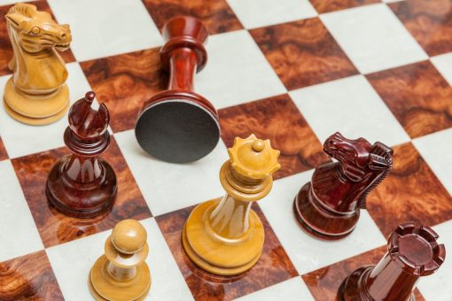 Staunton Evolution 4.25 inch chess pieces in Lacquered Padauk and Boxwood