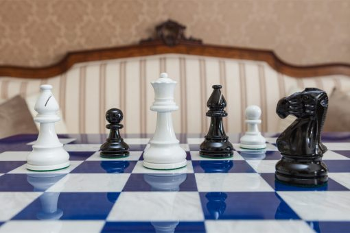 Black and White Earl chessmen on a blue board